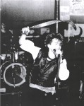 UK Decay's Abbo swirls his belt at the Manchester poly 1982. pics Kindly donated by P.Barlow