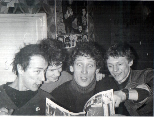 Two of UK Decay with friends at wellington street, reading a copy of The Suss fanzine. Spon, S. Harle, Captain and M. Dillingham